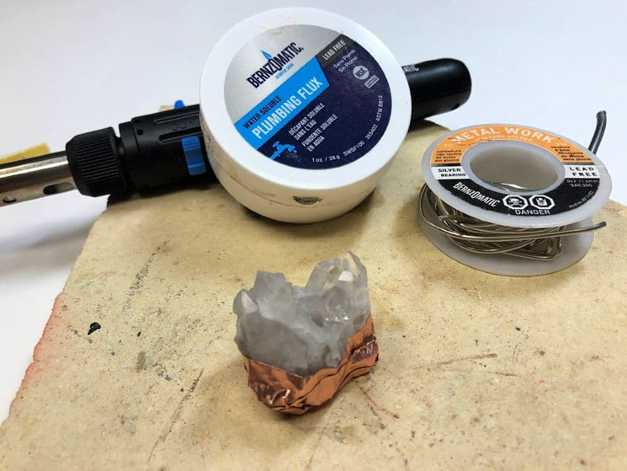 Crystal wrapped in copper tape for soldering