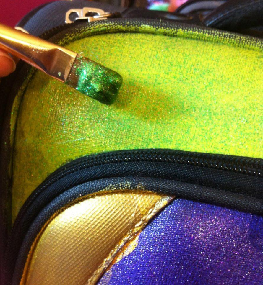 DIY glittered suitcase by Crafty Chica. #craftychica #glittercraft #paintedsuitcase