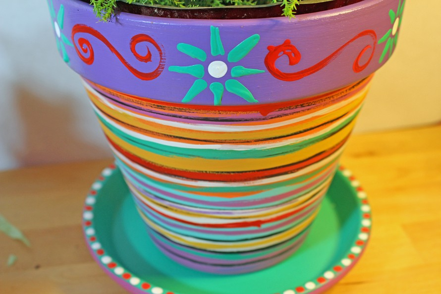 Here is a tutorial for painted flower pots by CraftyChica.com.