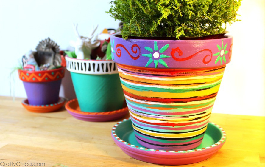 Painted flower pots by CraftyChica.com.