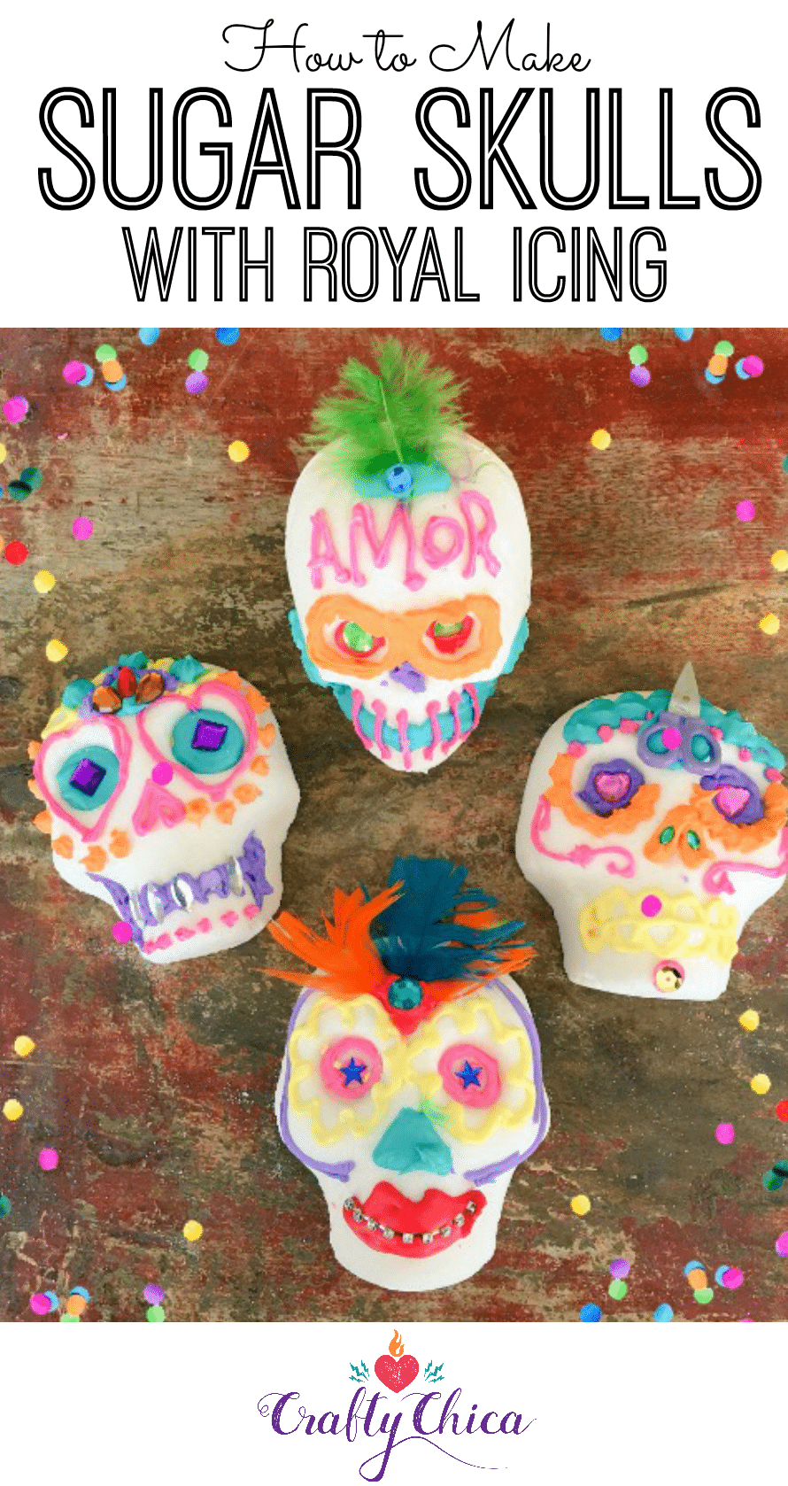 Decorated sugar skulls on a table with confetti.